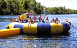 kids playing on giant water platform