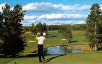 man golfing over waterway